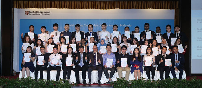 Malaysian students with their award certificates