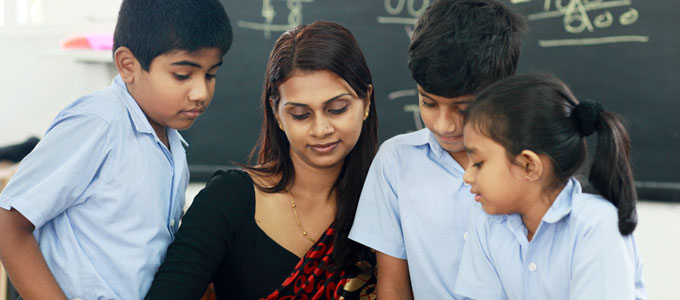 A Cambridge teacher with young students