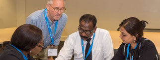 Facilitator with delegates at a conference